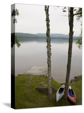 Two Kayaks Sit on Shore at Embden Pond in Maine-Hannele Lahti-Stretched Canvas Print