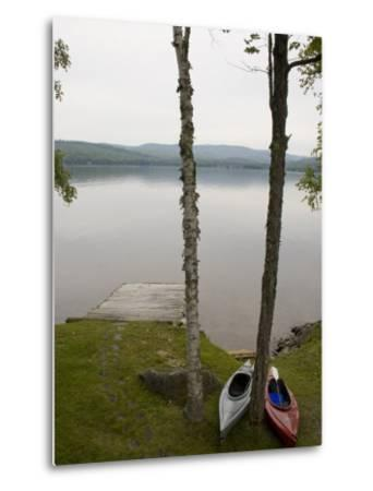 Two Kayaks Sit on Shore at Embden Pond in Maine-Hannele Lahti-Metal Print