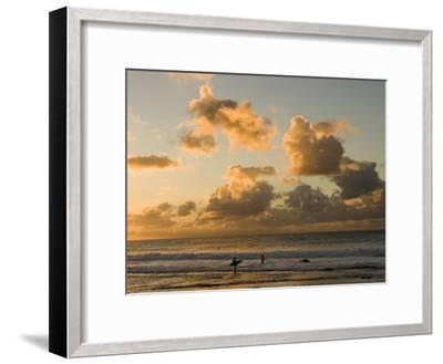 Two Surfers Enter the Pacific Ocean as the Sun Sets in Hawaii-Charles Kogod-Framed Photographic Print
