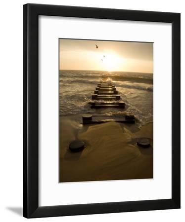 Atlantic Ocean Waves Break Against Pilings at Sunrise-Stephen St^ John-Framed Photographic Print