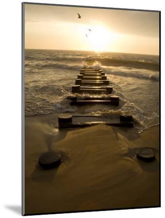 Atlantic Ocean Waves Break Against Pilings at Sunrise-Stephen St^ John-Mounted Photographic Print