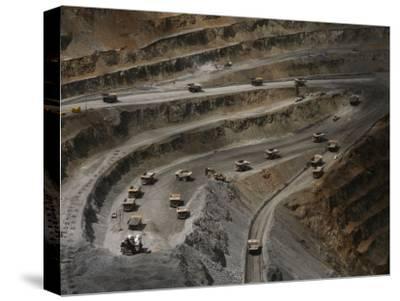 Trucks Hauling Waste Rock at Batu Hijau, a Copper and Gold Mine-Randy Olson-Stretched Canvas Print