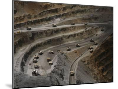 Trucks Hauling Waste Rock at Batu Hijau, a Copper and Gold Mine-Randy Olson-Mounted Photographic Print