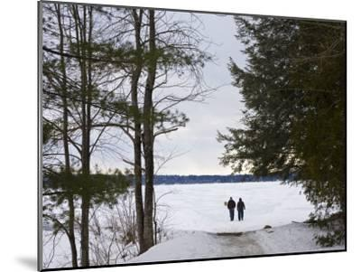 Two People Walk Out onto the Frozen Lake to Go Ice Fishing-Hannele Lahti-Mounted Photographic Print