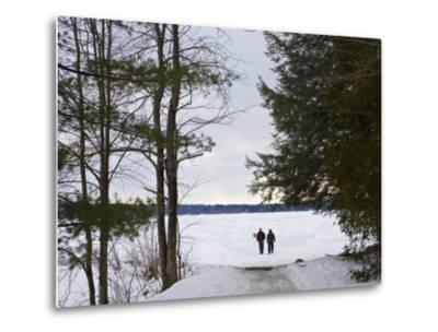 Two People Walk Out onto the Frozen Lake to Go Ice Fishing-Hannele Lahti-Metal Print