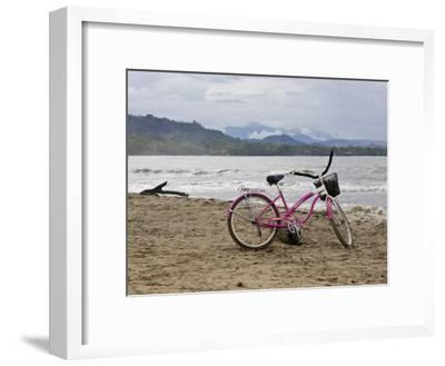 Pink Bike Sits on the Beach in Cahuita National Park-Hannele Lahti-Framed Photographic Print
