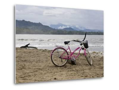 Pink Bike Sits on the Beach in Cahuita National Park-Hannele Lahti-Metal Print