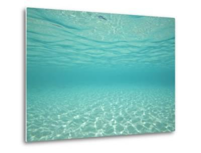 Underwater Shot of Clear Blue Water and White Sand-Michael Melford-Metal Print