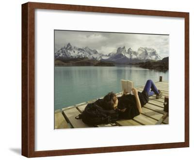 Woman Relaxes on a Dock While Reading a Book-Skip Brown-Framed Photographic Print