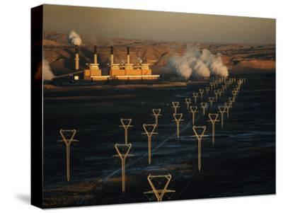 Coal-Fired Electric Plant and High Voltage Transmission Lines-Paul Chesley-Stretched Canvas Print