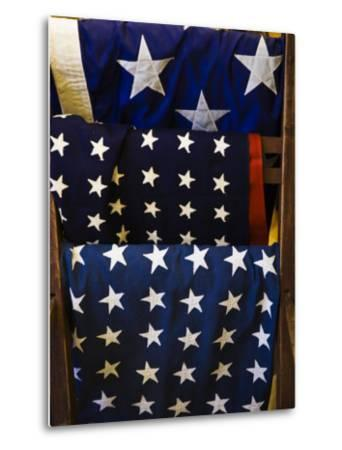 Us Flags Folded and Hanging from a Wooden Rack-Todd Gipstein-Metal Print