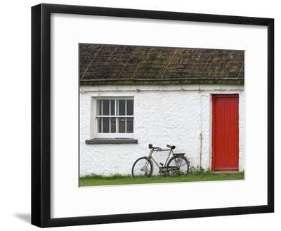 Historic Thatched Roof House with a Red Door and Old Bicycle-Rich Reid-Framed Photographic Print