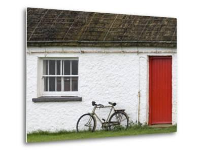 Historic Thatched Roof House with a Red Door and Old Bicycle-Rich Reid-Metal Print
