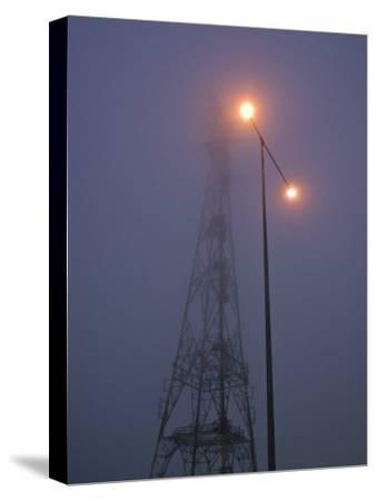 Electricity Tower and Freeway Lighting Emerge from Heavy Fog-Jason Edwards-Stretched Canvas Print