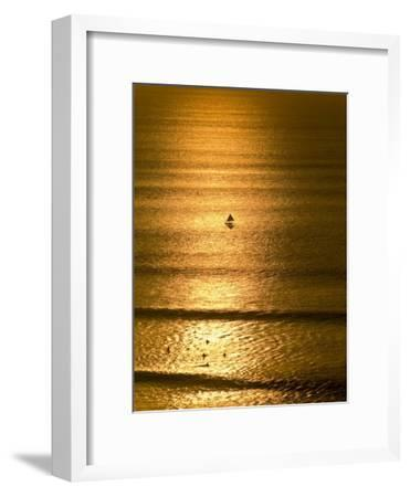 Small Fishing Boat Heads Out to Sea at Sunset Past Surfers-Jason Edwards-Framed Photographic Print