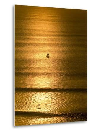 Small Fishing Boat Heads Out to Sea at Sunset Past Surfers-Jason Edwards-Metal Print