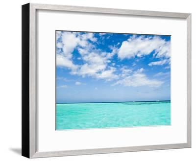 Cloud-Filled Sky and Clear Blue Waters of Ambergris Cay-James Forte-Framed Photographic Print