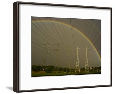 Vast Array of Electrical Towers and Cables Beneath a Huge Rainbow-Jason Edwards-Framed Photographic Print