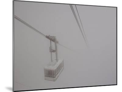 Cable Car Disappears into the Clouds Below Aiguille Du Midi-Melissa Farlow-Mounted Photographic Print