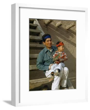 Native American Father and Son Dressed for a Dance Sit Together-Justin Locke-Framed Photographic Print