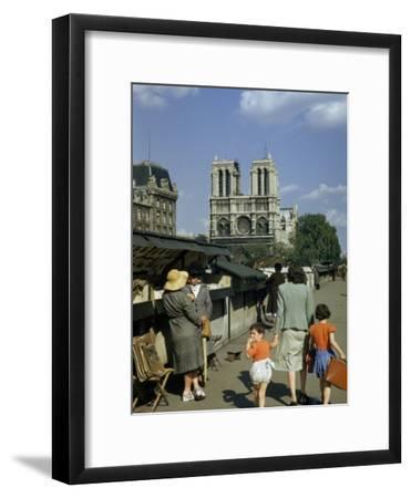 Mother Hurries Children Past Book Stalls Near Notre Dame De Paris-Justin Locke-Framed Photographic Print