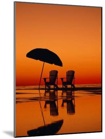Picturesque Scene with Two Chairs and an Umbrella on the Beach-Michael Melford-Mounted Photographic Print