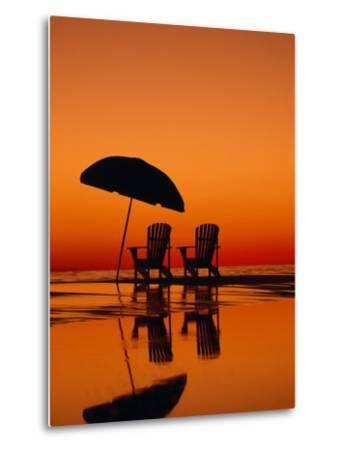 Picturesque Scene with Two Chairs and an Umbrella on the Beach-Michael Melford-Metal Print
