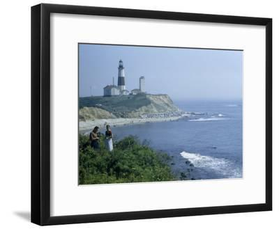 People Stand on Point across Bay from Montauk Point Light-B^ Anthony Stewart-Framed Photographic Print