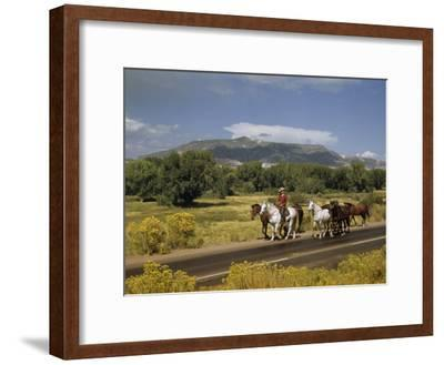 Rancher Leads His Horses on Country Road, Mountains Line Horizon-Justin Locke-Framed Photographic Print