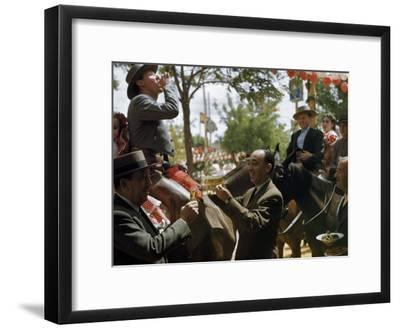Man Offers Passing Friends a Glass of Wine-Luis Marden-Framed Photographic Print