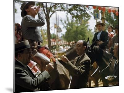 Man Offers Passing Friends a Glass of Wine-Luis Marden-Mounted Photographic Print