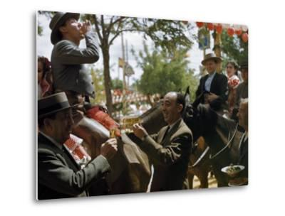 Man Offers Passing Friends a Glass of Wine-Luis Marden-Metal Print