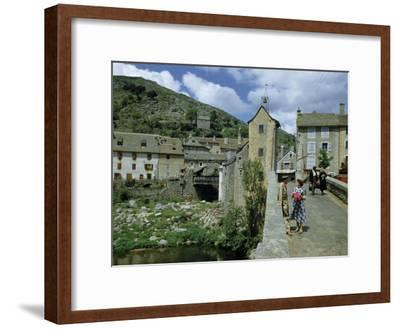 People in Riverside Village Walk across an Old Bridge-Walter Meayers Edwards-Framed Photographic Print