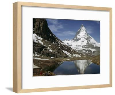 Tourists View the Matterhorn and its Reflection in Alpine Lake-Willard Culver-Framed Photographic Print