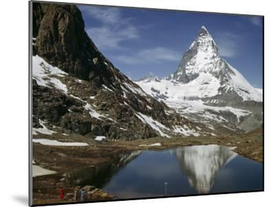 Tourists View the Matterhorn and its Reflection in Alpine Lake-Willard Culver-Mounted Photographic Print