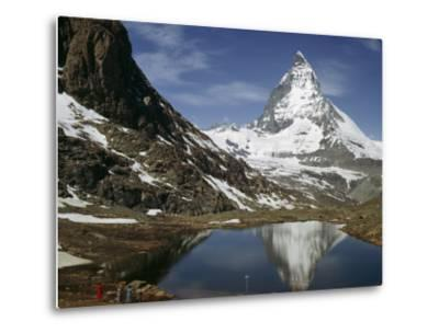 Tourists View the Matterhorn and its Reflection in Alpine Lake-Willard Culver-Metal Print