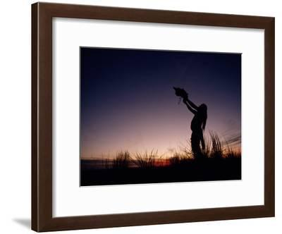 Native North American Holding an Artifact Up Towards the Sky-Chris Johns-Framed Photographic Print