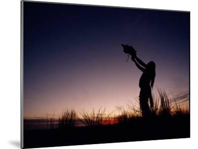 Native North American Holding an Artifact Up Towards the Sky-Chris Johns-Mounted Photographic Print