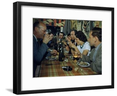 Restaurant Diners Eat Snails, Drink Wine, and Talk-Justin Locke-Framed Photographic Print