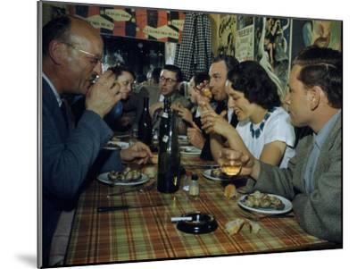 Restaurant Diners Eat Snails, Drink Wine, and Talk-Justin Locke-Mounted Photographic Print