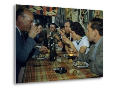 Restaurant Diners Eat Snails, Drink Wine, and Talk-Justin Locke-Metal Print