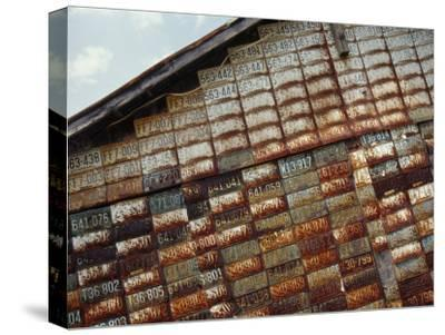Side of a Building Adorned with Old License Plates-Raymond Gehman-Stretched Canvas Print