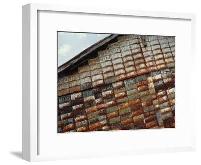 Side of a Building Adorned with Old License Plates-Raymond Gehman-Framed Photographic Print