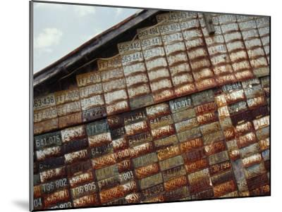 Side of a Building Adorned with Old License Plates-Raymond Gehman-Mounted Photographic Print