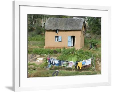 Clothes Drying on a Clothesline in Front of a House, Madagascar--Framed Photographic Print