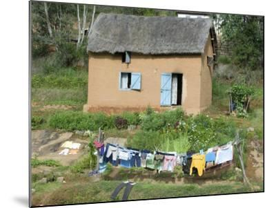 Clothes Drying on a Clothesline in Front of a House, Madagascar--Mounted Photographic Print