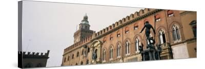 Statue in Front of Palace, Fountain of Neptune, Palazzo D'Accursio, Piazza Maggiore, Bologna, Italy--Stretched Canvas Print