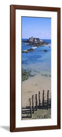 View of Wooden Posts on the Beach with a Fort in the Background, St-Malo, Brittany, France--Framed Photographic Print