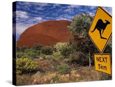 Alice Springs, Traffic Sign Beside Road Through Outback, Red Rocks of Olgas Behind, Australia-Amar Grover-Stretched Canvas Print