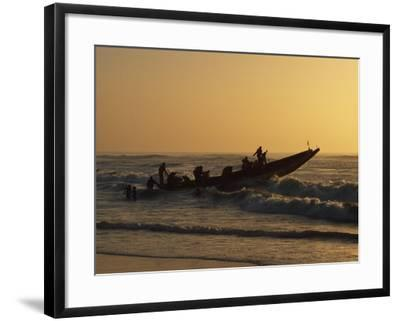 Fishermen Launch their Boat into the Atlantic Ocean at Sunset-Amar Grover-Framed Photographic Print